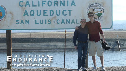 Cameron Craig and Nate Page stand at the San Luis Canal. They traveled to Central Valley, California to research the impact drought has on agriculture and the residents of Fresno.